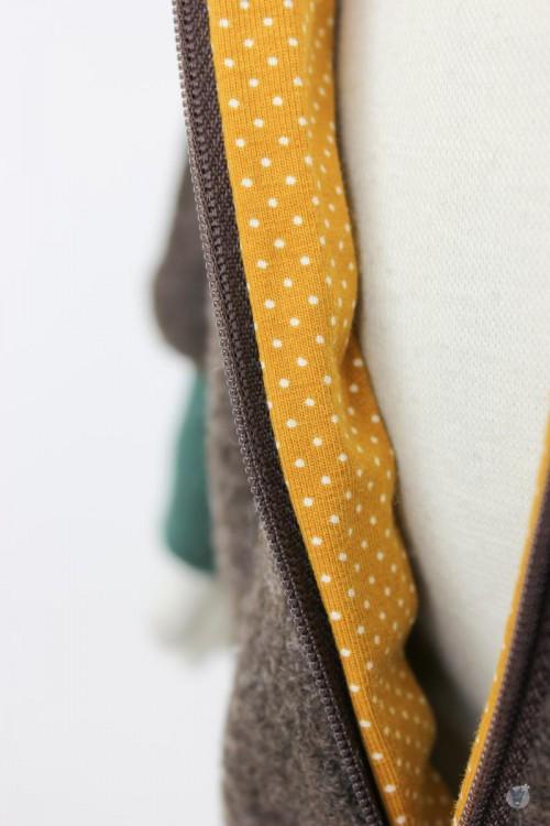 Kinder-Wollanzug braun mit Punkten auf gelb, wächst mit