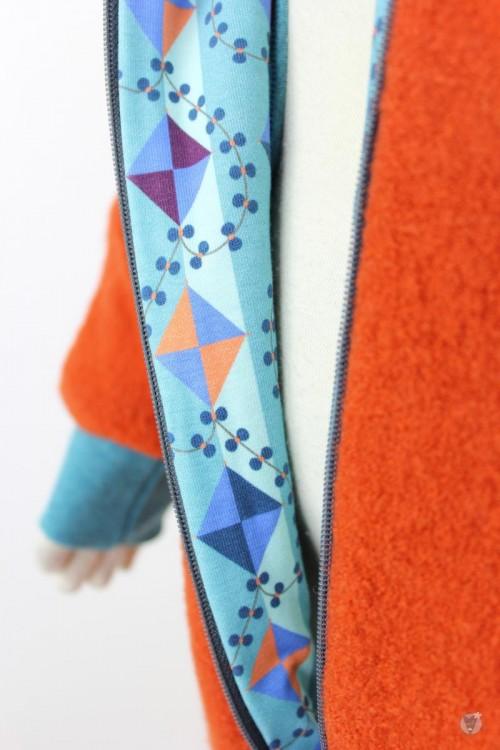 Kinder-Wollanzug orange mit Drachenmuster, wächst mit