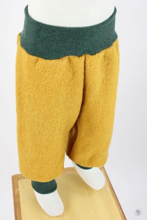 Wollhose gelb mit dunkelgrün melierten Bündchen
